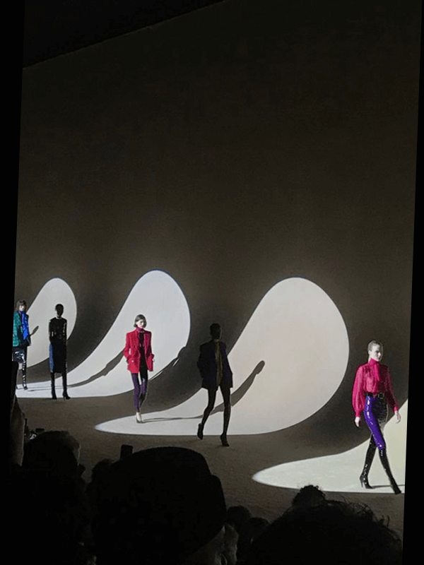 Digital Runway - Models walking down the runway from left to right in the spotlights